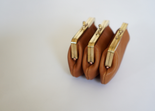 Triple gamaguchi purse