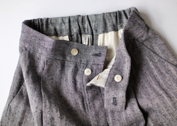 Tuck tapered trousers